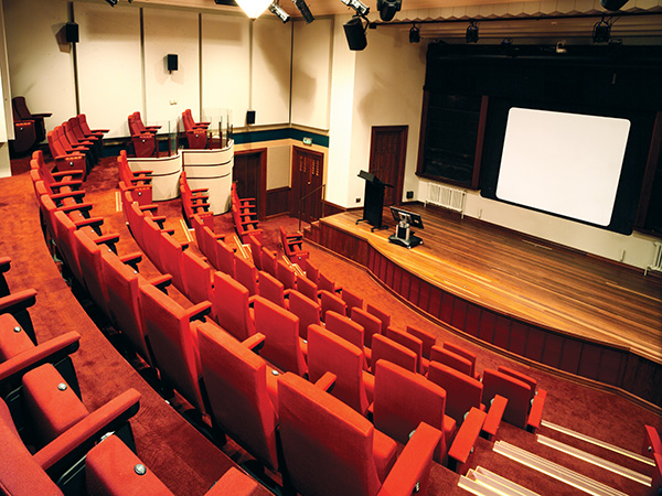 Despite a major refurbishment and technical upgrade, the former anatomy lecture theatre retains its heritage feel, right down to the steam radiators and the original angled film projection screen.
