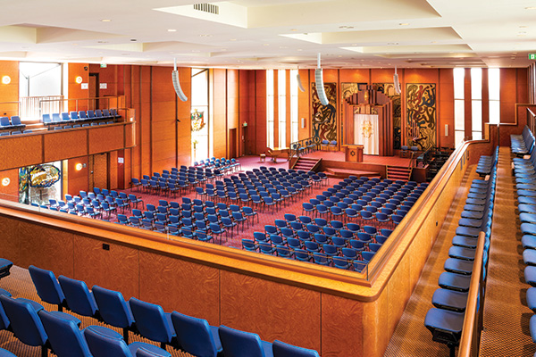 Temple Beth Israel in High Holy Day mode, accommodating 2000 people. Four Martin Audio Omniline arrays address the room. For the rest of the year, the podium is relocated forward and an operable wall closes off the front portion turning it into a multipurpose hall. The front arrays are then preset to be steered down for use as a  presentation PA for the hall.
